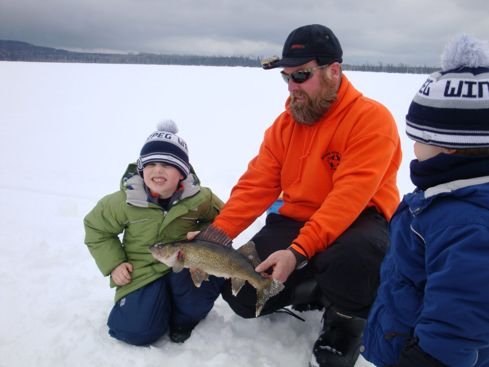 St paul ice fishing sport show woman river camp for Ice fishing show